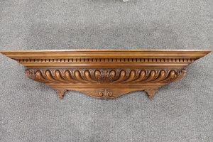 A carved mahogany cornice, width 110 cm.