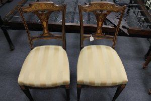 A pair of Victorian inlaid rosewood salon chairs. (2)