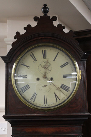 An early nineteenth century mahogany long cased clock, height 220 cm.