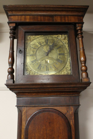 An eighteenth century oak long cased clock with brass dial by John Porthouf, Penrith, height 206 cm.
