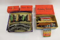 A Hornby O gauge clock-work Pullman train set, comprising track, Brake Van, Pullman Coach, Level Crossing no.1, points, and M Station set, partly boxed. (Q
