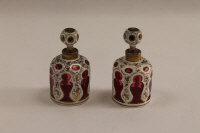 A pair of nineteenth century white enamel overlaid ruby glass flasks, height 9.5 cm. (2)