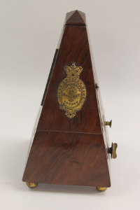A late Victorian rosewood metronome by Maezel, height 24 cm.