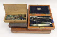An early twentieth century draughtsman's set in a fitted mahogany case by E.G. Wood, London, together with a mahogany artist's box, a later draughtsman's set and a boxed miniature set of scales. (4)