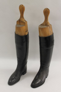 An early twentieth century pair of Lady's black leather riding boots with wooden trees, size 5.5. (2)