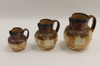 Three Doulton Lambeth stoneware jugs, with silver mounted rims. (4)