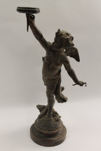 An early nineteenth century patinated spelter cherub gas lamp, on rouge marble base, signed L.Gregoire, height 60 cm.