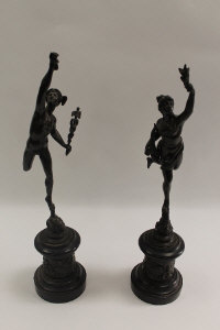 A pair of French bronze figures depicting Icarus and companion, on black slate plinths, height 52 cm. (2)