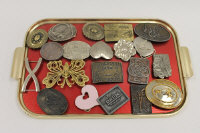 A Siskiyou Dixieland buckle, together with nineteen other vintage belt buckles. (20)