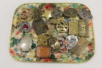 An Anacortes Brass Works buckle, together with nineteen other vintage belt buckles. (20)