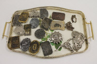 An Aspen Trophies buckle, together with nineteen other vintage belt buckles. (20)
