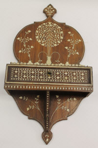 A nineteenth century Anglo Indian wall bracket, inlaid with ivory, fitted with a drawer, width 25 cm.