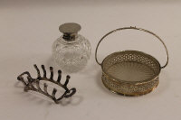 A silver glass lined pickle dish, together with a silver toast rack and silver topped dressing table flask. (3)