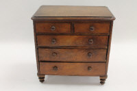 A Victorian mahogany apprentice type miniature chest of five drawers, height 28 cm.