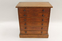 A Victorian stained beech wood miniature chest of six drawers, height 42 cm.