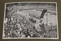 Three albums containing WW II Third Reich propaganda images and monochrome photographs. (3)