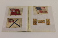 A collection of cigarette cards including silk national flags, British Regalia, and three cards bearing Taddy's Clown images.