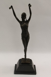 After Demetre Chiparus - An Art Deco style dancer on tip toes, bronze study on black marble base, height 60 cm.