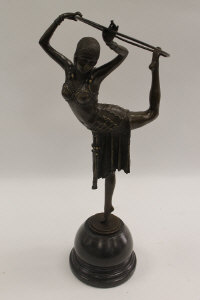 After Demetre Chiparus - An Art Deco style dancer with hoop, bronze study on black marble base, height 51 cm.