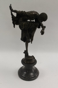 After Demetre Chiparus - An Art Deco style dancer with head down, bronze study on black marble base, height 44 cm.
