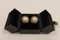A pair of 18ct gold pearl and diamond earrings. (2)