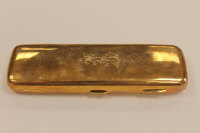 A solid 9ct gold spectacle case, 108.8g.