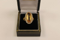 An 18ct gold diamond and citrine ring.