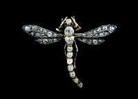 A late Victorian diamond dragonfly brooch, with sapphire eyes.