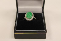A platinum green jade and diamond ring.