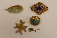 A Victorian brooch set with turquoise, together with another brooch set with an amethyst and two pendants. (4)