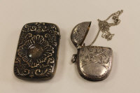 A silver vesta case, Birmingham 1902, together with another sterling silver vesta case. (2)