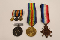 Three WW I medals awarded to W.H.Fraser, Eng. LT.CR. R.N., together with the miniature medals of the same group.