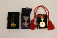 A fine Japanese enamel medal - Order of the Rising Sun, together with another Japanese medal - Order of the Sacred Treasure, each on suspension ribbons, contained in finely gilded lacquered boxes. (2)