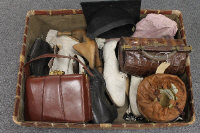 A wicker case containing vintage leather shoes, a crocodile skin handbag, mortar board etc. (Q)