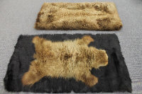 Two late nineteenth century animal fur rugs, lined, 97 cm x 157 cm. (2)