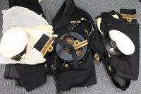 A large group of late nineteenth / early twentieth century Royal Navy uniforms and dress jackets, together with a box containing club decorations. (Q)