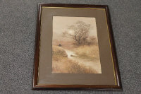 Twentieth century Japanese school : A fisherman by a river, watercolour, indistinctly signed, 46 cm x 31 cm, framed.