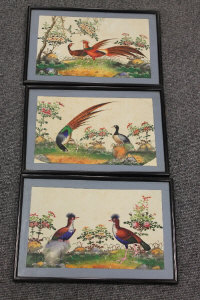 Early twentieth century Oriental school : Two pheasants in a garden, watercolour, 18 cm x 29 cm, together with two similar, all three parts framed. (3)