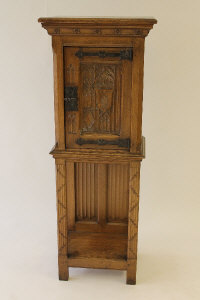 A carved oak cabinet, with gothic style panels, width 49.5 cm.