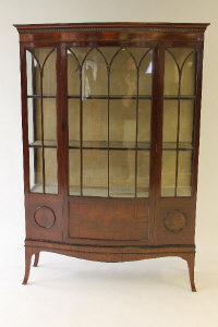 A Victorian mahogany bow-fronted display cabinet, width 123 cm.