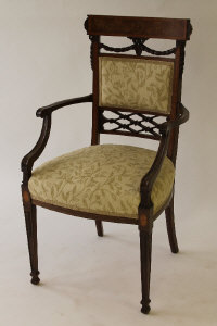 A Victorian inlaid mahogany armchair, width 52.5 cm.
