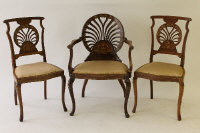 A Victorian inlaid mahogany salon armchair, together with a pair of matching single chairs. (3)