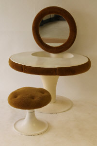 A 1970's moulded white poly resin dressing table and stool, width 112 cm.