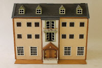 A large double fronted doll's house, width 127 cm.