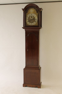 A nineteenth century mahogany longcased clock by Kidd, Malton, with brass and silvered dial, height 208 cm.