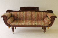 A Victorian mahogany scroll end settee, width 216 cm.