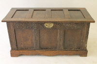 An eighteenth century and later carved oak blanket chest, width 117 cm.