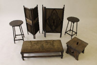 An Edwardian oak long footstool, together with an oak stool, two oak occasional tables and two folding screens. (6)