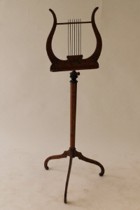 A nineteenth century music stand with painted decoration.