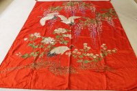 A late nineteenth / early twentieth century Oriental embroidered silk cloth, together with a pair of matching cushion covers. (3)